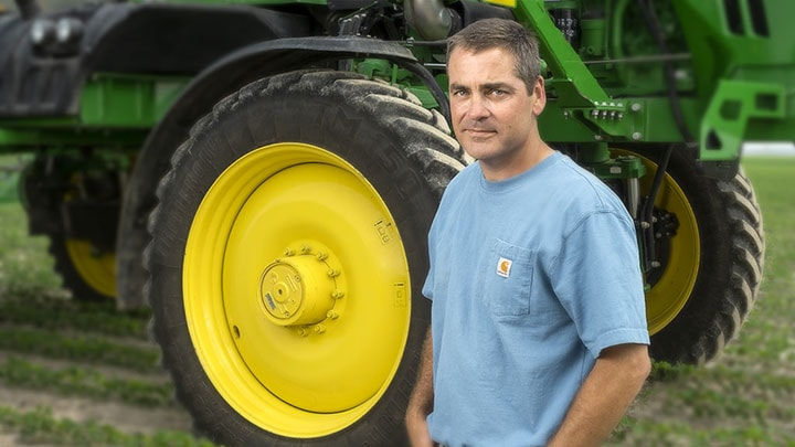 Davis-Petter-in-front-of-his-tractor