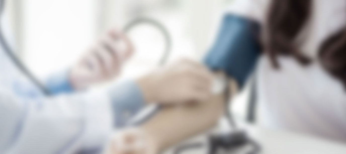 Blurry picture of patient getting blood pressure test