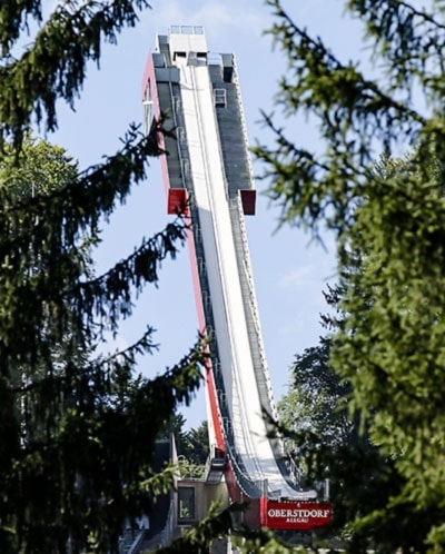 Ski flying tower behind trees