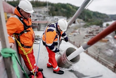 Two men working with bridge cables